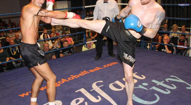 Best foot forward: Johnny 'Swift' Smith kicking his way to victory against Yuhei Tsuda