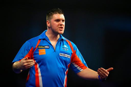 feel good: Daryl Gurney celebrates after defeating Jamie Lewis to become the first player to reach the second round of the World Championship