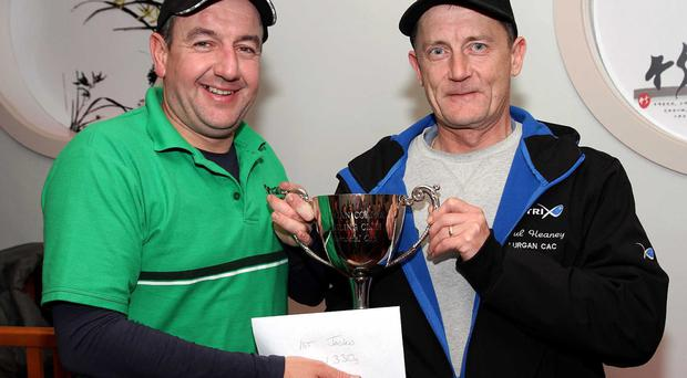 Proud moment: Philip Jackson receives the Memorial Cup from Lurgan CAC Secretary Paul Heaney
