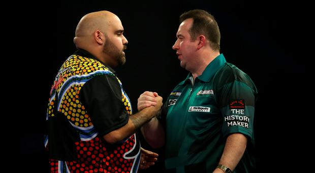 Mixed fortunes: Brendan Dolan (right) after last night's defeat to Kyle Anderson