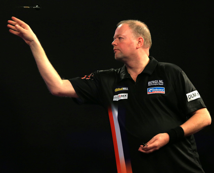 Best shot: Raymond van Barneveld on his way to a 3-0 success against Dirk van Duijvenbode last night at Ally Pally