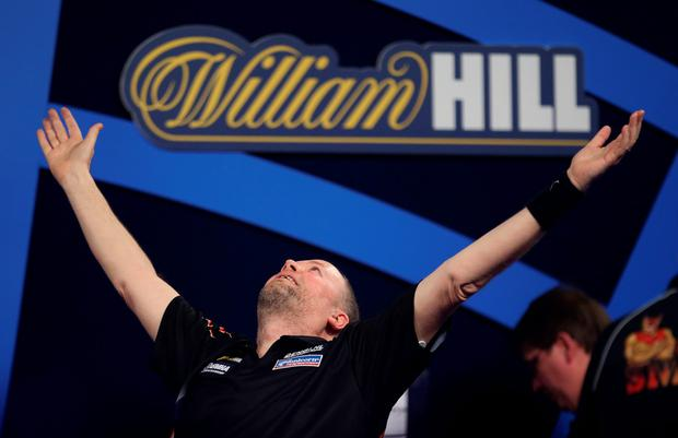 Marching on: Raymond van Barneveld celebrates his stunning comeback win over Michael Smith at Alexandra Palace