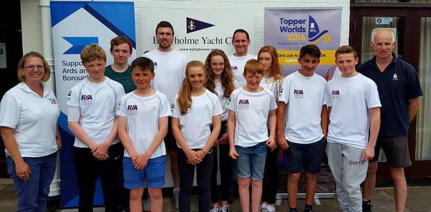 Top class: Michelle Hill and Andy Millington of the International Topper Class Association, pictured with Royal Yacht Association NI's Richard Honeyford and Chris Penney and the Topper RYANI squad ahead of the Topper Worlds at Ballyholme Yacht Club
