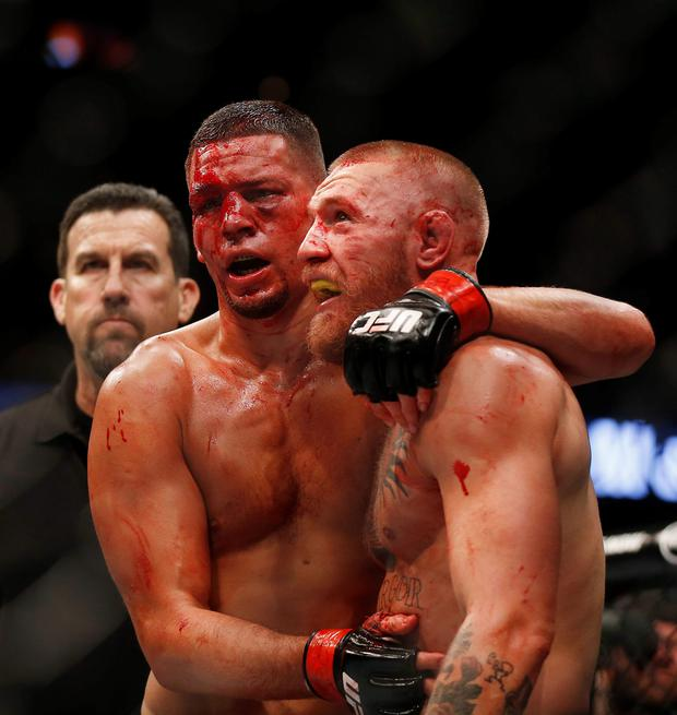 Bloodied: Conor McGregor and Nate Diaz after their incredible battle