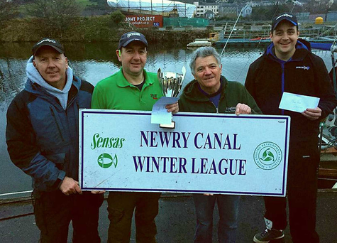 Top rod: Newry Canal Winter League winner Philip Jackson (second left) receives his prize from organiser Geoff Quinn (second right), with David Hamilton (left) who was second and Johnny McKinley who finished third