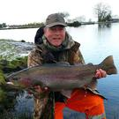 No ordinary Joe: well pleased Joe O'Neill shows off his 10lb 14oz full finned, beautifully marked, Craigmore rainbow trout