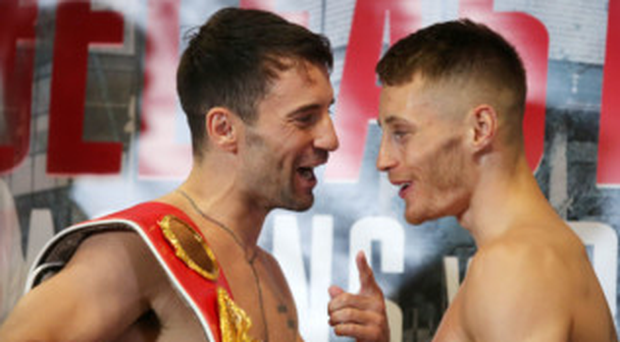 Fighting talk: Lee Haskins and Ryan Burnett stoke the fire at yesterday's weigh-in at the Hilton Hotel