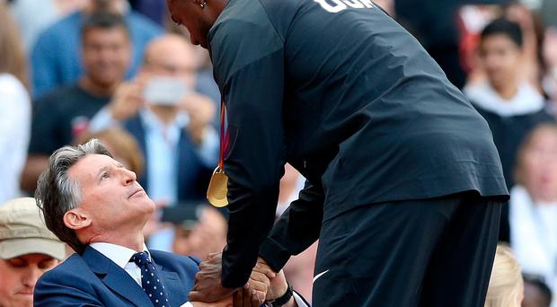 Uncomfortable: Lord Coe presents Gatlin with his medal