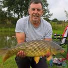 Taylor-made: Dave Taylor from Glengormley, with a cracking 15lb 1oz common carp which he caught on a method feeder using 3mm and 6mm pellets and an 8mm pellet on a banded hook length at the Carp and Tench Lake at the Straid Fishery, Ballynure