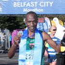 Golden performances: Gideon Kipsang shows off his medal after winning the Belfast Half Marathon