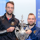 On the draw: Nigel Jones (left), captain of holders CIYMS, with opponents Armagh represented by Gareth McCarter