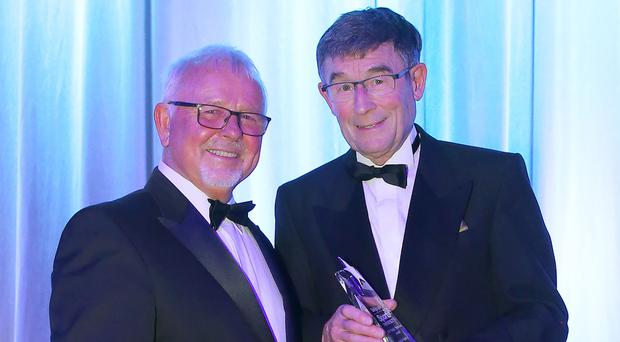 Big contribution: NI Sports Forum chief Roy Millar with winner David Seaton last year
