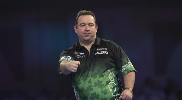 Marching on: Brendan Dolan celebrates his win over Benito van de Pas at Ally Pally