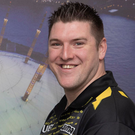 Mighty task: Daryl Gurney (right) takes on Michael van Gerwen tonight