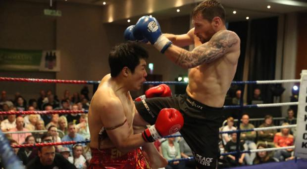 Dominant display: Johnny Smith on his way to victory over Lee Jihoon