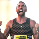 Running man: Stephen Scullion celebrates as first Irish finisher in October's Dublin Marathon