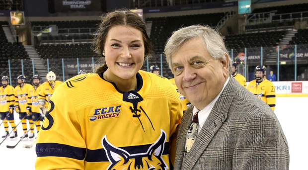 Ace student: the player of the game award is presented to Lexie Adzija by Joe Bertagna, Commissioner of Hockey East Conference
