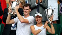 Winners: Jamie Murray and Martina Hingis celebrate their Mixed Doubles title at Wimbledon in 2017