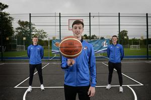 High hoops: CJ Fulton, Conor and Aidan Quinn at the new outside basketball courts at St Malachy's