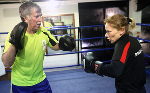 Ring star: Cathy McAleer is put through her paces during training with John Breen at his gym in west Belfast