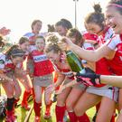 Just fizzing: Pegasus celebrate landing the EY Irish Hockey League title on Saturday with one game to spare