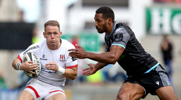 Big impact: Craig Gilroy is closed down by Ratu Tagive