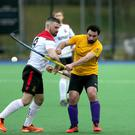 Pressure on: Instonians' Phil Hamill (right) and Newry's John Taylor clash at Shaw's Bridge