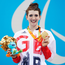 Golden smile: Bethany Firth proudly displays her third gold medal at the Paralympics in Brazil