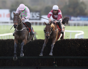 Up and over: Irish-trained Outlander (right) is top weight for the Aintree Grand National