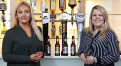 Winning team: Emma Meehan, left, Chief Executive of Down Royal Racecourse and Jordana Busby, Customer Director NI at Molson Coors