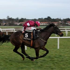 Sir Des Champs gallops on strongly to the line