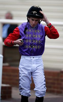 Top job: Ryan Moore in The Queen's colours at Salisbury yesterday