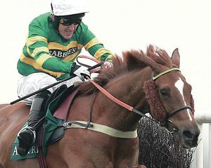 AP McCoy en route to winning the Pinsent Masons Manifesto Novices' Chase on board Uxizandre during the opening day of the Crabbie's Grand National yesterday afternoon