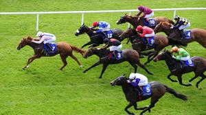 Shanghai Glory (left) scores at the Curragh