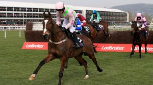 Vautour ridden by Ruby Walsh on his way to winning the JLT Novices' Chase at Cheltenham