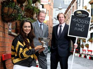 Festival fever: Grand National-winning jockey, and Channel 4 presenter, Mick Fitzgerald (centre), with Down Royal general manager Mike Todd and Miss Northern Ireland Rebekah Shirley at yesterday's launch of the Down Royal Festival, Ulster's richest race meeting