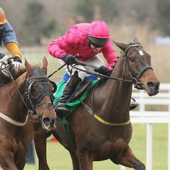 Monksland, right, wins the Christmas Hurdle