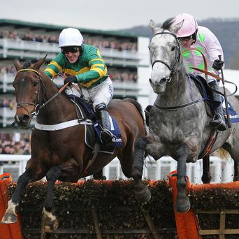 Champagne Fever (right) jumps the last with My Tent Or Yours