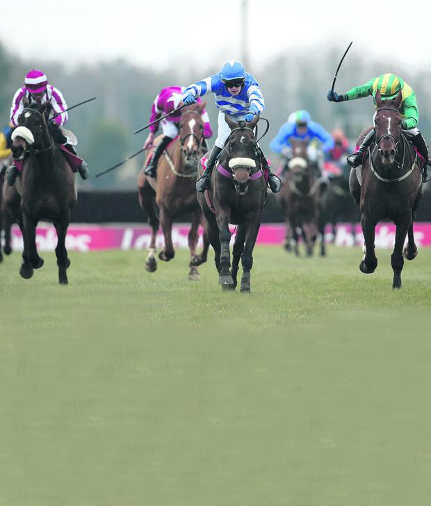 Jockey Ben Dalton onboard Liberty Counsel (centre) on his way to winning The Ladbrokes Irish Grand National