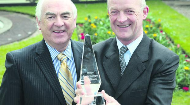 Willie Mullins, champion jumps trainer, is pictured with Cel O'Reilly, MD Philips Ireland, having received the Philips sports manager award for March 2013