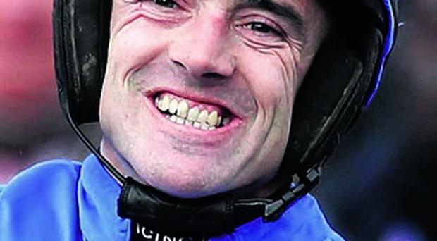 Ruby Walsh celebrates winning the Stan James Champion Hurdle on Hurricane Fly