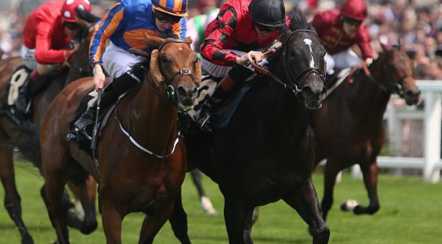 Gale Force Ten, left, ridden by Joseph O'Brien, battles back close home to win the Jersey Stakes
