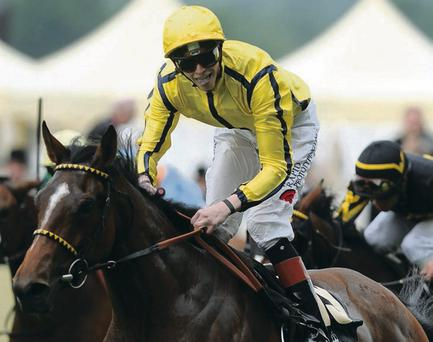 ASCOT, ENGLAND - JUNE 19: James Doyle riding Rizeena wins the Queen Mary Stakes during day two of Royal Ascot at Ascot Racecourse on June 19, 2013 in Ascot, England. (Photo by Charlie Crowhurst/Getty Images for Ascot Racecourse)