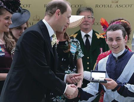 The Earl of Wessex presents Jockey Wayne Lordan with his trophy after winning the Duke of Cambridge Stakes with Duntle during day two of the Royal Ascot meeting at Ascot Racecourse, Berkshire