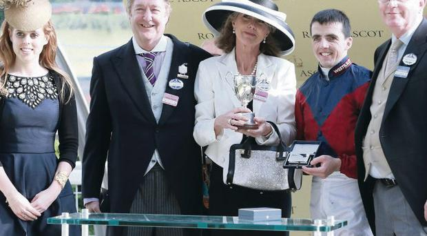 ASCOT, ENGLAND - JUNE 20: Princess Beatrice, who presented The King George V Stakes Cup to Julia and Jon Aisbitt, owners of Elidor, ridden by Martin Harley and trainer Mick Channon on Ladies' Day during day three of Royal Ascot at Ascot Racecourse on June 20, 2013 in Ascot, England. (Photo by Chris Jackson/Getty Images for Ascot Racecourse)
