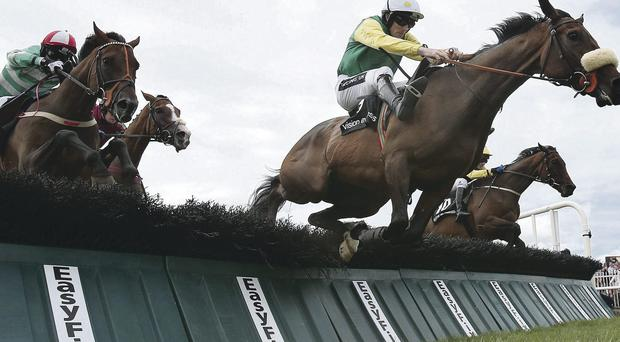 On form: Busted Tycoon under Ruby Walsh jumps the last to win at Galway yesterday