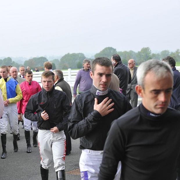 Ruby Walsh leads the jockeys back after inspecting the track