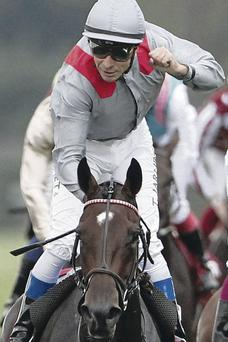 We've done it: Thierry Jarnet celebrates after winning the Qatar Prix de l'Arc de Triomphe on Treve yesterday at Longchamp