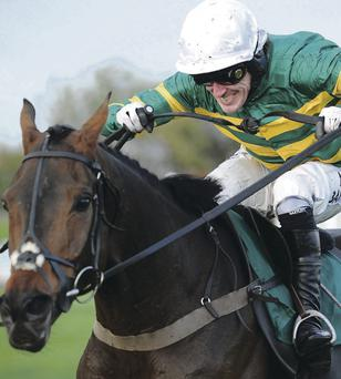 Tony McCoy triumphs in the Weatherbys Handicap Steeple Chase on Eastlake yesterday, the first of an Aintree double, as the Ulsterman's march towards 4,000 winners gathers pace