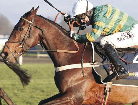 In front: Tony McCoy wins Christmas Hurdle on My Tent Or Yours